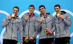 Day 4: (L-R) Gold Medallists Ryan Lochte, Conor Dwyer, Ricky Berens and Michael Phelps pose on the podium.