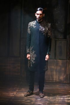 By designer Sabyasachi, Black sherwani with antique gold sequences patch detailing and black churidaar. Shop for your wedding trousseau, with a personal shopper & stylist in India - Bridelan, visit our website www.bridelan.com #Bridelan #Indiangroom #Sabyasachi