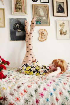 Daisy print dress with black polka dot tights :)