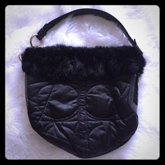 Coach - Black Rabbit Fur Trimmed Bag  #G05K-3586 Coach - Black Rabbit Fur Trimmed Handbag:  used, good condition. Minor flaws on the inside lining as noted in the last picture - a couple make up spots and partially broken zipper (it still functions open/close but is missing the tab). Coach Bags Shoulder Bags