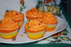 Orange Cupcakes decorated for fall with leaf sprinkles.  Everyone said they tasted like Dreamscicles!