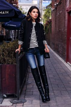 striped shirt, bomber jacket, skinny jeans, thigh-high boots #brunch #outfits via @glamour