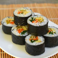 Gimbap satisfies in many settings: as a light lunch for both adults and kids, as an easy-to-carry picnic and hiking snack, or even as a party appetizer. Learn the basics of these Korean-style seaweed and rice rolls and you'll be able to fill them with endless combinations of vegetables, meat, tofu, and eggs. They're even a great way to use up leftovers!