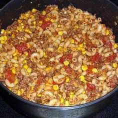 Hillbilly Dinner  ½ cup · uncooked elbow macaroni 1 ½ pound · ground beef 1 teaspoon · garlic powder 1 · (8 ounce) can tomato sauce 1 cup · stewed, diced tomatoes 1 · (15 ounce) can whole kernel corn, drained 1 · salt & pepper to taste  chopped, onion