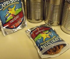 Use a capri sun.  Velcro and snack bags are ready! Easy and fun for the kiddos,