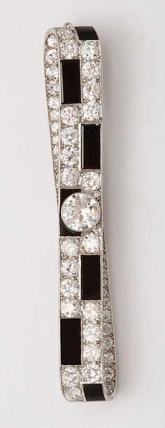 Art Deco onyx and diamond bar pin set in platinum.  by Cartier  Paris, ca. 1920