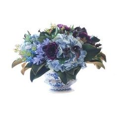 """Create a lush tablescape or charming vignette with this lovely faux hydrangea and lilac arrangement, nestled in a Delft-style vase for classic appeal.  Product: Faux floral arrangementConstruction Material: Polyester, plastic and ceramicColor: Eggplant and blueFeatures: Includes faux hydrangeas and lilacsDimensions: 13.5"""" H x 16"""" Diameter"""