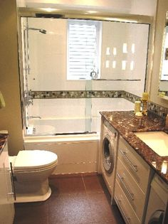 IDEA: Basement bath with laundry area. Maybe for guests, and if so, have 2 sets of washers and driers to get all of your laundry done right away.