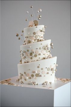 White, silver, gold and pink cake