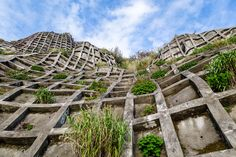Concrete grid cells installed on a steep hillside to reduce erosion. Aogashima island, Japan.