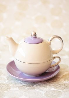 "Cream & purple tea pot & cup set from Ruche. This reminds me of Mrs. Potts from Disney's film ""Beauty And The Beast."""