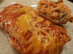 Stephs yummy and super easy bean and cheese enchilada recipe!--I wouldn't go with frozen burritos but sauce might be worth a shot.