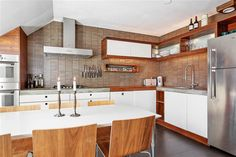 Cool tiles and concrete top and hood and wallnut colour