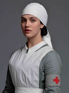 Actress Jessica Brown-Findlay played Lady Sybil Branson (nee Crawley), in Downton Abbey, TV series in series 1 to series 3 (Photo Jessica Brown Findlay, Sybil Downton, Downton Abbey Castle, Lady Sybil, Vintage Nurse, Red Cross, Blouse, It Cast, Arrow