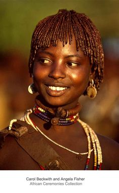 Africa | A Hamar bride from Ethiopia beautifies her skin and hair with a mixture of ocher and animal fat. Omo Valley, Ethiopia. | ©Carol Beckwith and Angela Fisher