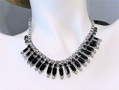 ITEM # 011703  Beautiful signed Joseph Warner 1950s black and crystal rhinestone glass necklace/choker.  Necklace consists of black and crystal glass rhinestones that have all been hand prong set and set in a rhodium plating. This is a true choker length measuring at 14. The center section is approx 1 on the drop.  A little history on Joseph Warner jewelry:  Joseph Warner started his company in 1953. The Warner jewelry produced is known for its high quality workmanship and superior and b...