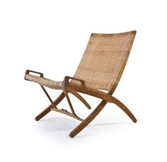 Hans J. Wegner Folding Chair for Johannes Hansen | From a unique collection of antique and modern lounge chairs at http://www.1stdibs.com/furniture/seating/lounge-chairs/
