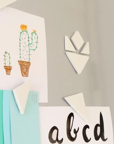 This is a cute air dry clay project for home decor. It also has a template to download to make the project tutorial even easier. DIY Tangram Magnets – Surely Simple