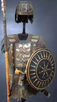 Moro (Philippine) warriors armor, mail and plate helmet with mail and plate shirt, shield. Regions Of The Philippines, Philippines Culture, Battle Dress, Filipino Culture, Filipino Tattoos, Military Figures, Arm Armor, Medieval Armor, Old World