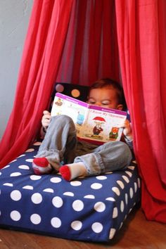 Upcycle a crib mattress to create a reading nook! Love this idea!