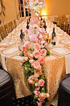 Pink garland centerpiece, gold linen