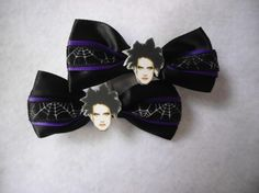 The Cure Hair Clips by KristenxKadaver on Etsy, $6.00...for the girls.