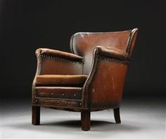 Club Armchair with wonderfully worn leather. Danish furniture producer 1930/40s. With heavy Art Deco feelings