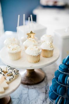 Vanilla frosted and gold sprinkled holiday cupcakes: http://www.stylemepretty.com/living/2016/12/16/family-traditions-you-can-start-this-holiday-season/ Photography: Daniel Kim - http://www.danielkimphoto.com/
