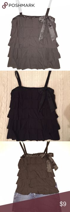 Ann Taylor Loft Black ruffle tiered tank sz small Ann Taylor Loft Black ruffle tiered tank top with bow detailing on left shoulder. Size small. It's an adorable top. Per the sizing, it runs larger - so will fit a small or medium person/bust. Shop my closet and ask for a bundle. Thank you! LOFT Tops Tank Tops