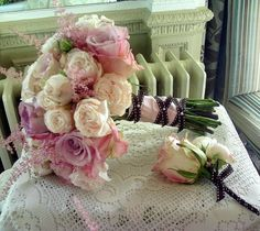Hand tied bouquet of Faith and Bombastic roses