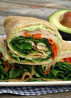 For a healthy, protein-packed lunch- Creamy Avocado Turkey Wrap featuring an avocado and Greek yogurt spread, your favorite vegetables, cheese and slow roasted turkey breast Turkey Wrap Recipes, Turkey Wraps, Dinner Recipes, Healthy Wraps, Healthy Snacks, Healthy Eating, Healthy Recipes, Healthy Protein, Slow Roasted Turkey
