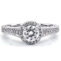 From Scott Kay's Cascade Collection, exclusive to Jared, this is a stunning one-quarter carat total weight designer engagement ring. Encircling the center stone of this lovely engagement ring is a setting lined with brilliant round diamonds. For additional allure, hand-set diamonds adorn the band. This exquisite display is set in 14K white gold and available only at Jared and Jared.com. The center diamond sold separately.