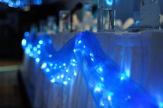 Head table idea..white lights under light green or gold tool