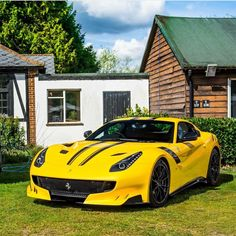 Ferrari F12 TDF painted in Giallo Tristrato w/ Black central stripes  Photo taken by: @xricox on Instagram