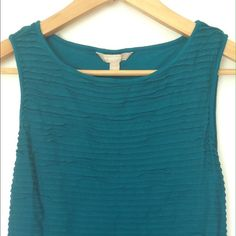 Banana Republic Teal Ruffled Tank EUC Banana Republic tank that looks great with skinny jeans and even better with white pants.  The color is a jewel toned teal. Banana Republic Tops Tank Tops