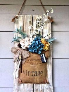 Hanging Vintage Porch Decor Ideas. -vintage use plain burlap. Flower Decor Ideas #palntdecor #flowerdecor #homedecor #plants #flowers #ideas #flowerarrangement