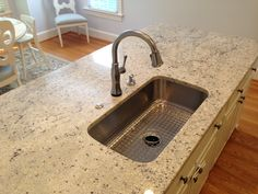 Kohler Untertone sink w/ Delta Touch faucet (9197T-DST Arctic Stainless).  Both Special Ordered from Lowe's.  Air switch button operates garbage disposal.