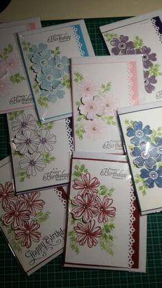 These are lovely - same basic card  with variation in the flower and color decoration - would make a good beginer class project