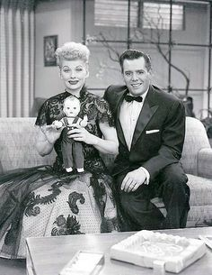 "Lucy and Desi with ""Little Ricky"" Doll. Photo taken on the I Love Lucy ""Hollywood"" set."
