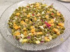 An Easy Healthy Choice for A Side dish with any meal!  Green Pea Salad  Follow this Pin to See the Full Recipe!