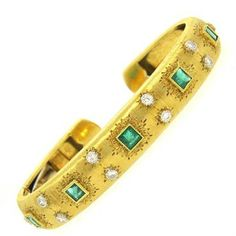 """8k yellow gold cuff bracelet, crafted by Mario Buccellati, decorated with approx. 1.45ctw in emeralds and 0.40ctw in G/VS diamonds. Bracelet will comfortably fit up to 7"""" wrist and is 11mm wide DESIGN"""