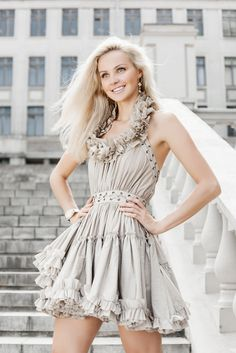 This girl has a SUMMER skin tone. Her pale skin makes the off white dress look good. Summer skin tones can wear white, but typically won't.
