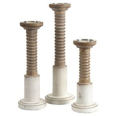 Showcasing an antiqued white base and turned details, this wood candleholder brings a touch of charm to your dining room table or master suite dresser.