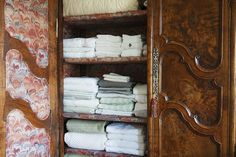 An armoire used for storing linens with custom upholstered panels. Villa Sophia designed by Juan Carretero, Lonny Dec/Jan Upholstered Panels, Home, Closet Design, Organizing Your Home, Apartment Cleaning, Linen Closet, Fabric Panels, Linen, Doors Interior