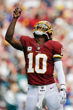 Week 11 - Redskins QB Robert Griffin III celebrates after throwing a touchdown.