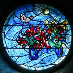 Marc Chagall stained glass window for La Chapelle du Saillant, 1982. Le maître évoque les quatre éléments : le bleu clair pour l'air, le rouge profond pour la terre, le vert pour la végétation et le jaune pour le feu. Traversé par un rayon lumineux, symbole de l'Esprit, survolé par un oiseau blanc, symbole de la paix. Colours represent the 4 elements: blue for air, red for earth, green for vegetation and yellow for fire with a beam of light for the spirit and a white bird of peace.
