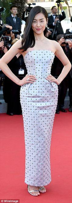 Studded sensation: Model Liu Wen wore a strapless, metallic-embellished dress...