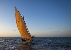 Dhow in sunset - Lamu Kenya. Photo by Eric Lafforgue.