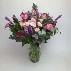 #Floraldisplay of #pink, #purple and #lilac #flowers in a #vase, with #greenery including #Eucalyptus. Lilac Flowers, Flower Vases, Pink Purple, Greenery, Bouquets, Glass Vase, Seasons, Gifts, Dwarf Lilac