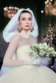 e444a8b24a8c1 'funny face' refresh- audrey hepburn in vera wang gown with bulgari  earrings.